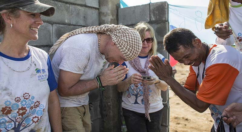 Volunteers greeting local workers in Cambodia - construction site