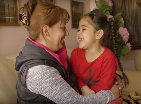 Happy Roma family in slums settlements