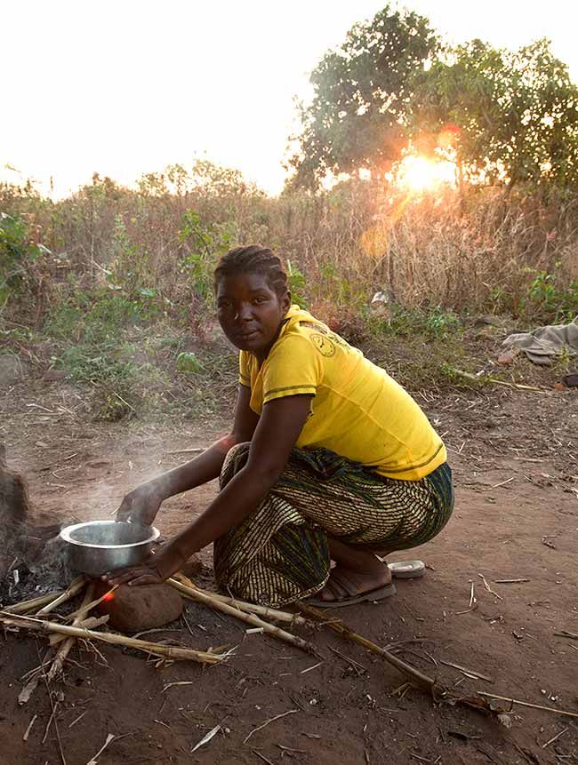Vulnerable children in Malawi needing new homes - cooking outside