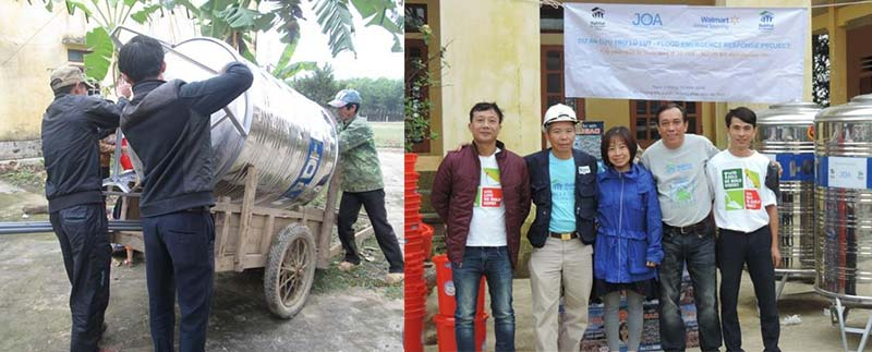 charity installing safe water tanks in vietnam floods