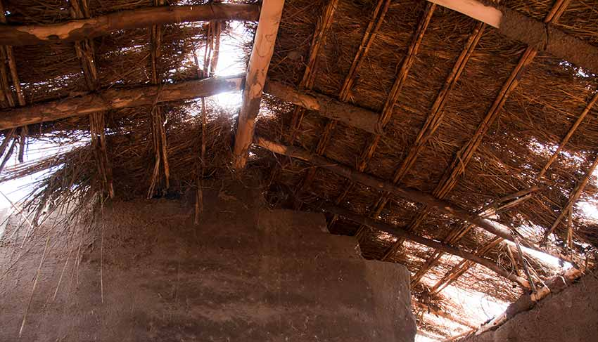 thatched roof extreme poverty in Malawi