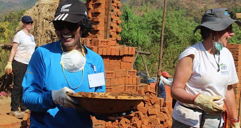 Women volunteers build homes in India