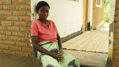 Housing in malawi, beneficiary woman