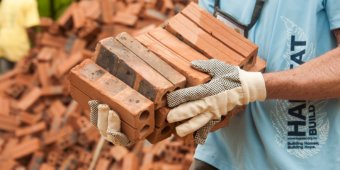 housing poverty Myanmar with bricks