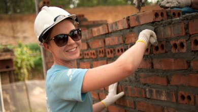 international volunteer trip laying bricks