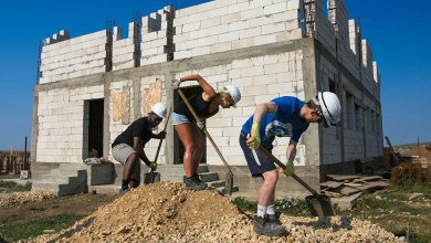 volunteers building social housing romania