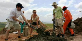 volunteers fight housing poverty south africa