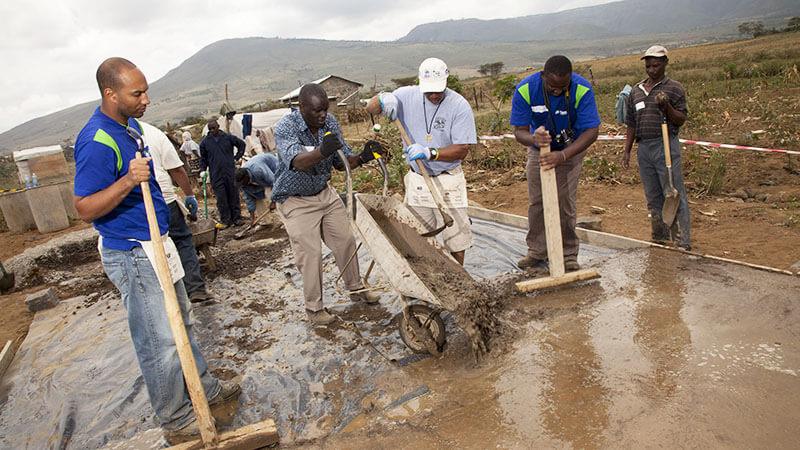 Volunteers building homes for victims of violence in Kenya
