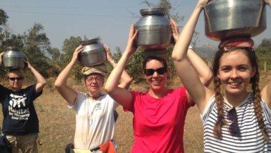 Volunteers water carry in India